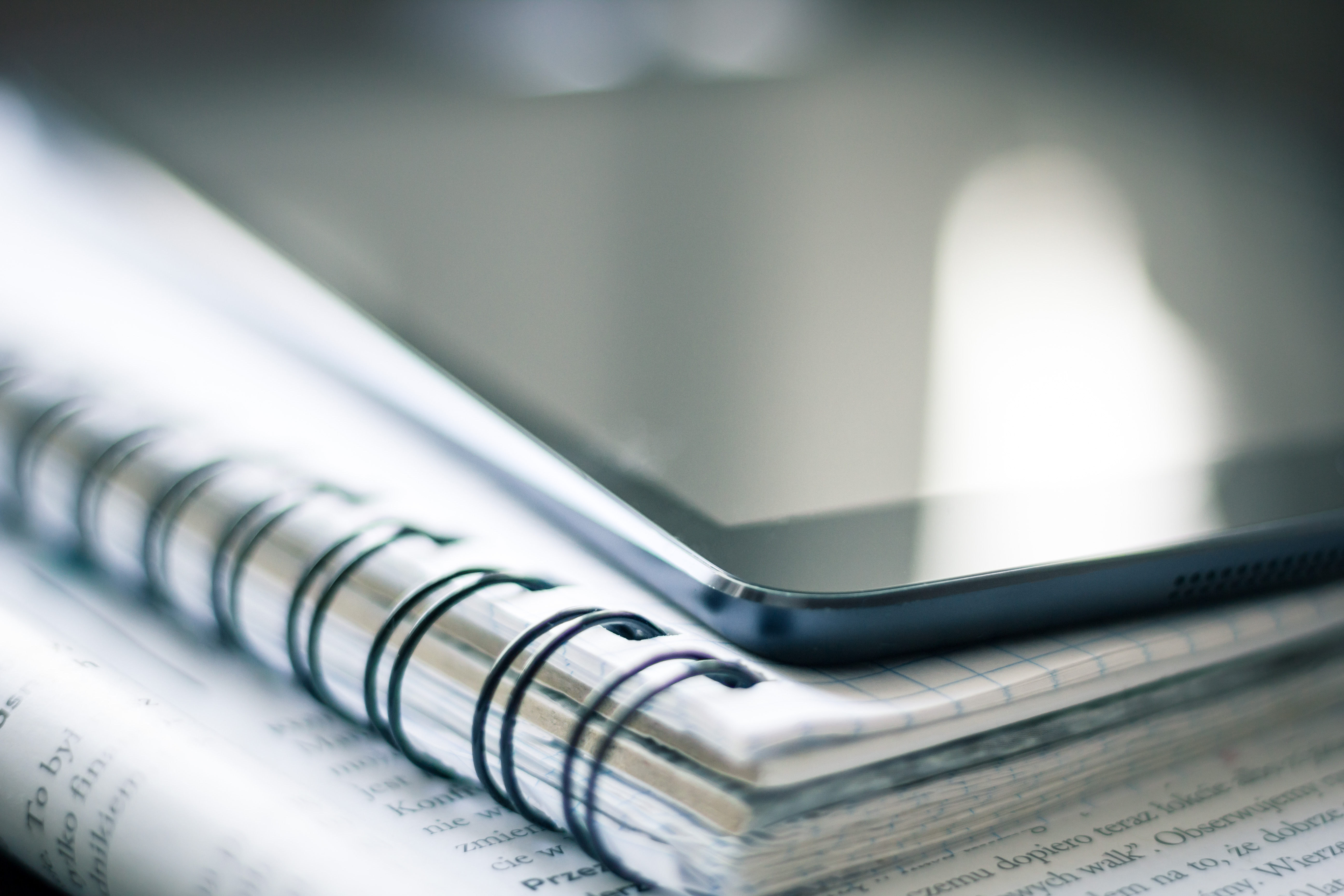 paper notebook and Ipad app