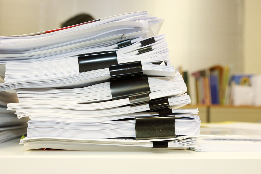 stack of disorganized lawyer paperwork
