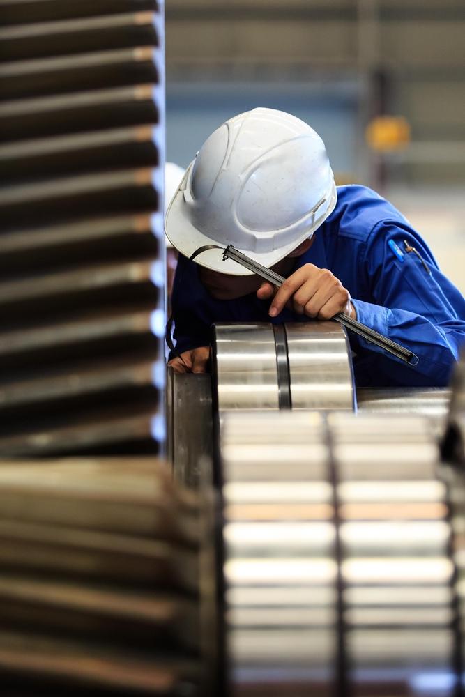 Technician Examining Gears