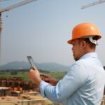 Man holding smartphone on construction site
