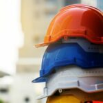 Colorful stacked construction helmets