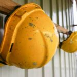 Construction safety helmets hanging on the wall