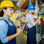 Woman holding mobile app in warehouse