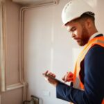 man holding tablet performing home inspection