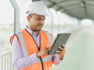 Man holding tablet on construction site