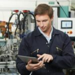 Man looking at tablet for an inspection