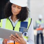 site manager filling out OSHA compliance forms on tablet