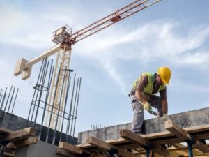 construction worker working on beam at construction site with job safety analysis