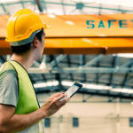 construction worker filling out near miss reports on phone