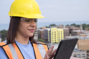 builder contractor at jobsite on tablet