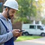 contractor using app on smart phone