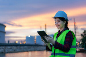 woman on job site using a tablet to perform a quality control inspection