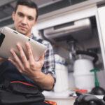 field technician works on an ipad for repair maintenance service