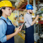 man and woman on tablet in warehouse